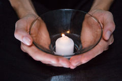 Hands holding candle Stock Images