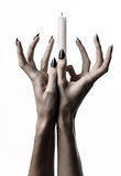 Hands holding a candle, a candle is lit, white background, solitude, warmth, in the dark, Hands death, hands witch. Studio stock photos