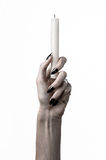 Hands holding a candle, a candle is lit, white background, solitude, warmth, in the dark, Hands death, hands witch Royalty Free Stock Photo