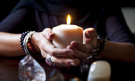 Hands holding a candle. Female hands holding a burning candle Royalty Free Stock Photos