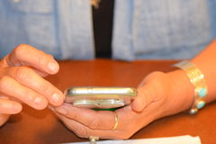 Hands holding cell phone. Front view of Hands holding cell phone Stock Photo