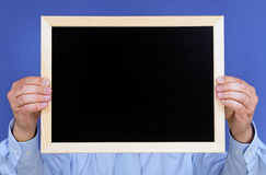 Hands holding chalkboard Royalty Free Stock Photography