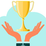 Hands holding champion cup Royalty Free Stock Photography