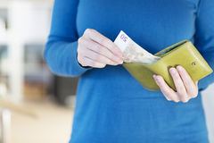 Hands holding change purse with European Euro currency Royalty Free Stock Photography