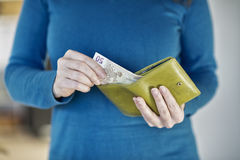 Hands holding change purse with European Euro currency Stock Photos