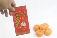 Hands holding a Chinese New Year Red Packet Stock Photo