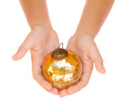 Hands holding christmas ball Stock Photography