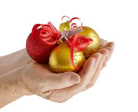 Hands holding  Christmas balls Stock Photography