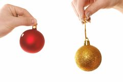Hands holding Christmas balls Royalty Free Stock Photo