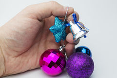 Hands holding Christmas decorations. Royalty Free Stock Photography