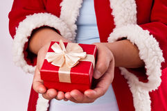 Hands holding Christmas gift box Royalty Free Stock Photos