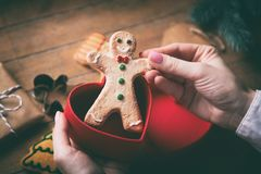 Hands holding christmas gingerbread man Stock Image