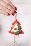 Hands holding Christmas ornament Royalty Free Stock Image