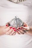 Hands holding Christmas ornament Royalty Free Stock Photos