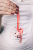 Hands holding Christmas ornament Stock Photos