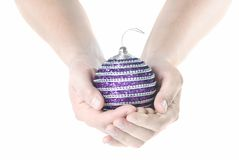 Hands holding christmas pink ball Stock Images