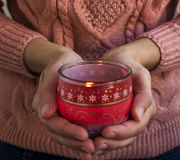 Hands Holding Christmas Scent Candle Stock Image
