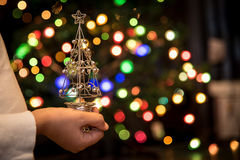 Hands holding Christmas tree ornament Royalty Free Stock Photography