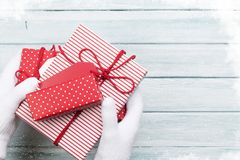Hands holding christmas or valentines day gift Stock Photos