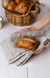Hands holding ciabatta bread. On a rustic linen cloth against white wooden background royalty free stock photos