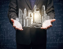 Hands holding city sketch Stock Photo