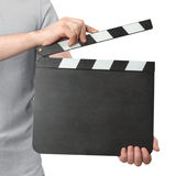 Hands holding clapper board isolated on white background. Closeup of man holding blank clapper board isolated on white background Royalty Free Stock Photography