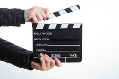 Hands holding clapperboard Stock Photo