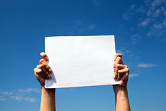 Hands holding clean white sheet paper Stock Image
