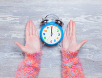Hands holding clock Stock Photo
