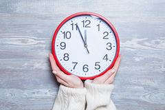 Hands holding clock Royalty Free Stock Images