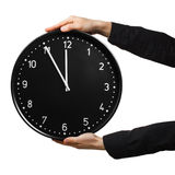 Hands holding clock Stock Image