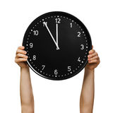 Hands holding clock Royalty Free Stock Photo