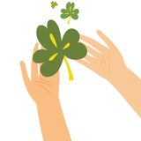Hands holding clover leaf. This is file of EPS8 format Stock Image