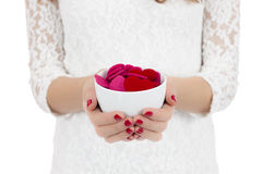Hands holding coffee cup with hearts in it Royalty Free Stock Photo