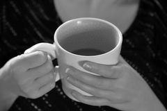 Monochrome Black and White hands holding coffee royalty free stock photography