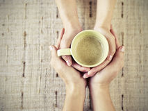 Hands holding coffee Royalty Free Stock Image