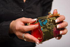 Hands holding coin purse Stock Image