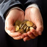 Hands holding coins Royalty Free Stock Images