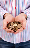 Hands are holding coins Stock Image