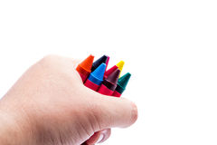 Hands holding color crayons Stock Photography