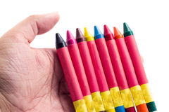 Hands holding color crayons Royalty Free Stock Image