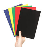 Hands holding color paper sheet Stock Images
