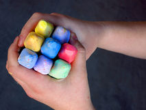Hands Holding Colored Chalk Royalty Free Stock Images