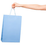 Hands holding colored shopping bags on white background Stock Images