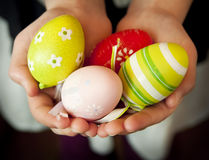 Hands Holding Colorful Easter Eggs Stock Photos