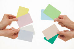 Hands holding colorful paper cards Royalty Free Stock Photography