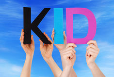 Hands Holding Colorful Straight Word Kid Blue Sky Royalty Free Stock Photo
