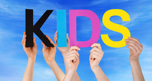 Hands Holding Colorful Straight Word Kids Blue Sky Royalty Free Stock Photography