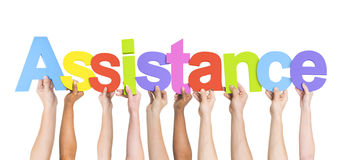 Hands Holding Colorful Word Assistance. Multi-Ethnic Hands Holding Colorful Letters To Form Assistance Stock Images