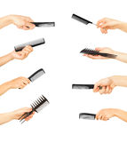 Hands holding combs and brushes Royalty Free Stock Photography